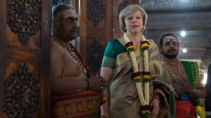 Prime Minister Theresa May visits the Sri Someshwara Hindu temple in Bangalore on the final day of a three-day trade mission designed to pave the way for close commercial links with the south Asian giant after Brexit.